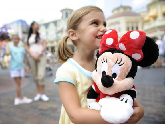Little girl with Minnie Mouse at Walt Disney World